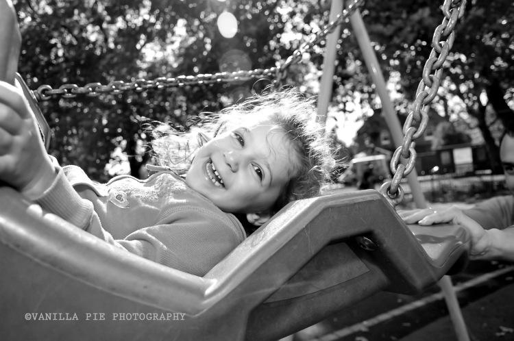 Child in swing, having fun