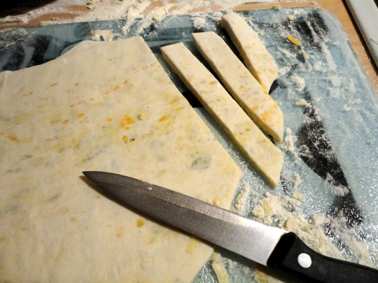 Pastry cut into strips to make cheese twists