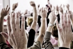 Raised hands, voting