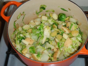 Sprout soup ingredients sizzling in a pan
