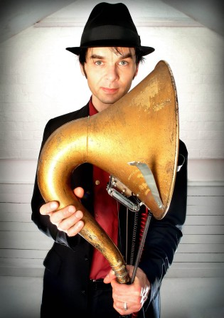 Thomas Truax holding a gramaphone.  Photo: Chris Saunders
