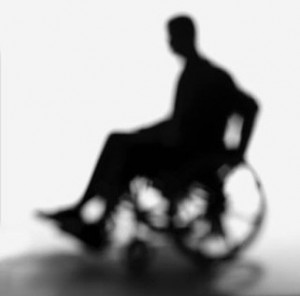 Person using a wheelchair in shadow
