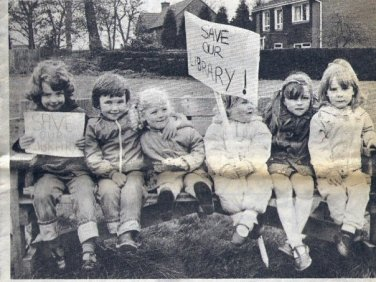 Newspaper clipping of children protesting to save a library