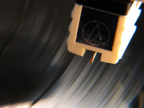 Record player - close up of needle above a moving record.  Photo: Great Beyond