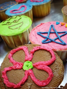 Home made cakes decorated with bright icing.  Photo: Nona Fara
