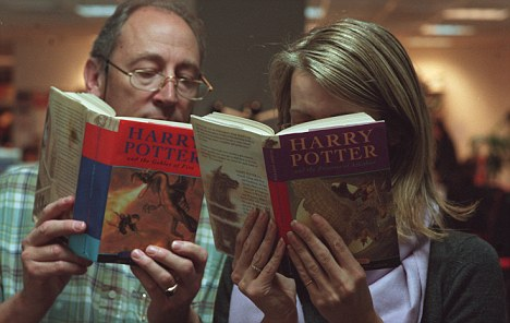 adults reading Harry Potter