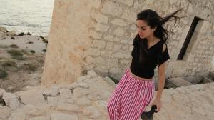 Djanan Turan in red stripey pants