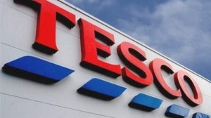 tesco logo on the side of a store to illustrate an opinion piece on workfare