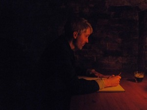 Padraig Whelan writing in the dark
