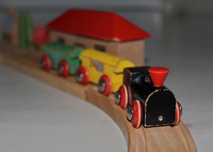 Toy trains on a wooden track.  Photo: Carnicula