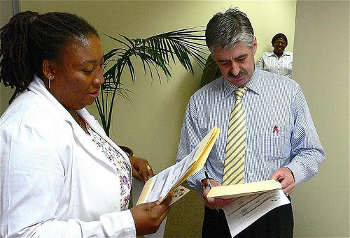 Doctor and patient discussing consent forms.  Photo: GC Communication